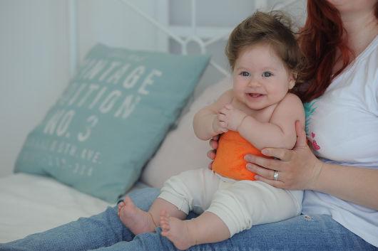 Как использовать пояс от коликов для новорожденных?
